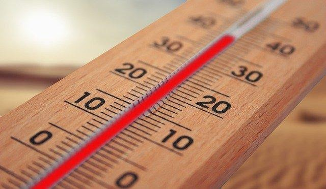 A thermometer symbolizing temperature loss, representing the need to choose the right attic insulation for your home